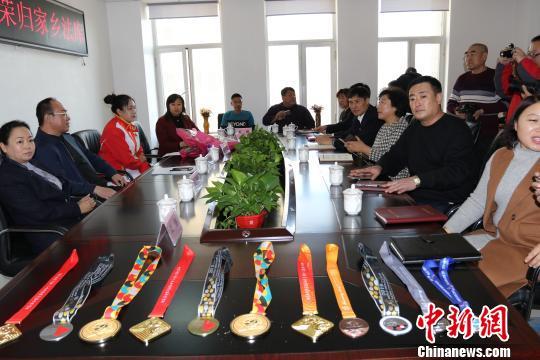 世界冠军徐凤雪载誉归故乡沈阳 获聘高级顾问